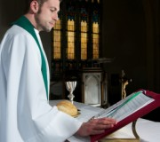 priest saying mass